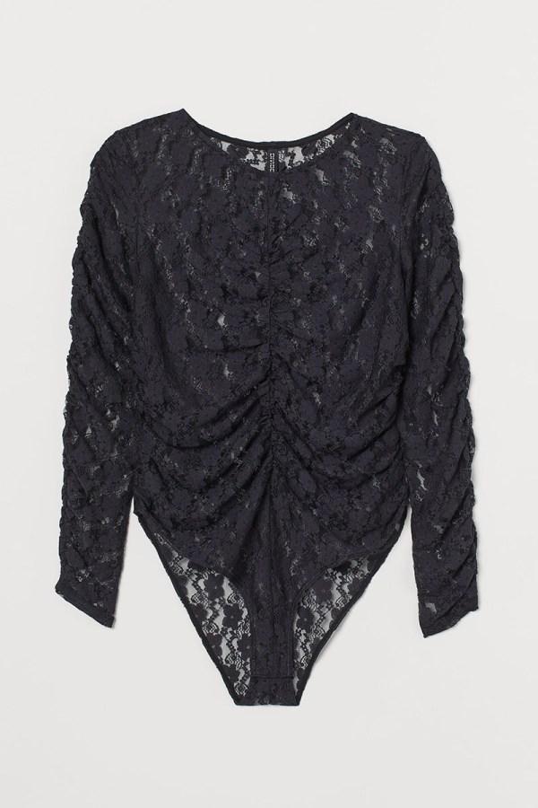 A plus-size black lace ruched bodysuit.