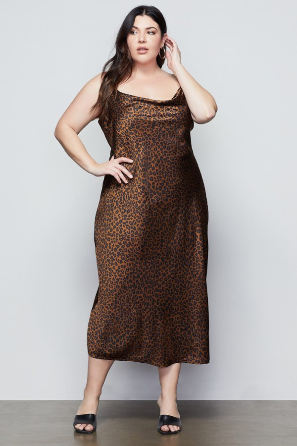 A plus-size model wearing a sexy leopard print slip dress.