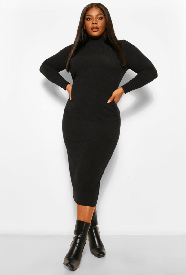 A plus-size model wearing a sexy black turtleneck dress.