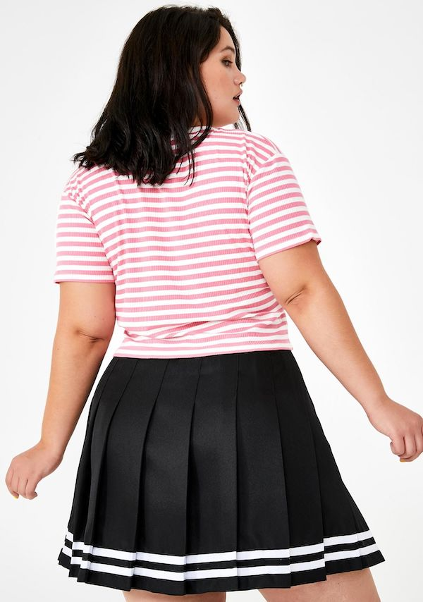 A model wearing a plus-size tennis skirt.
