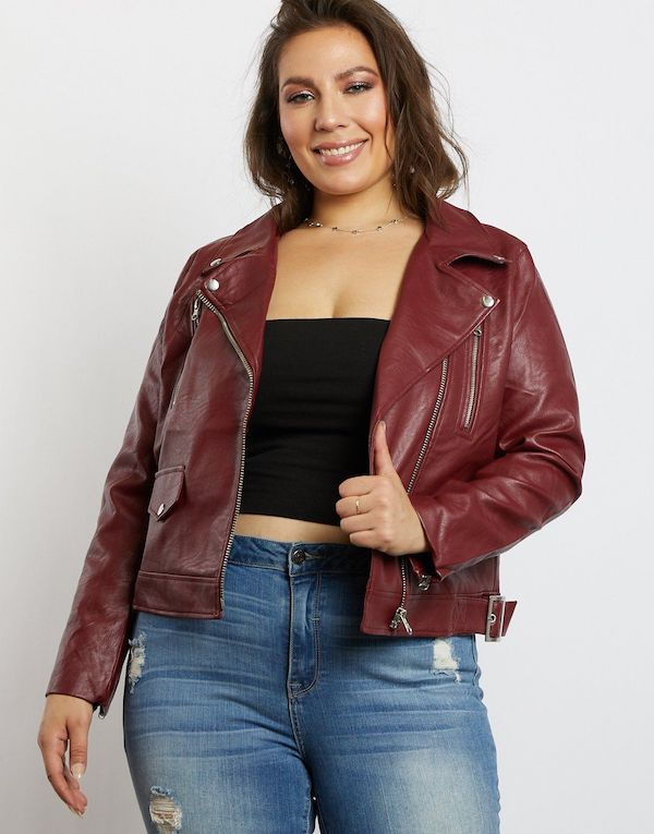 A plus-size model from 2020AVE wearing a dark red moto jacket in faux leather.