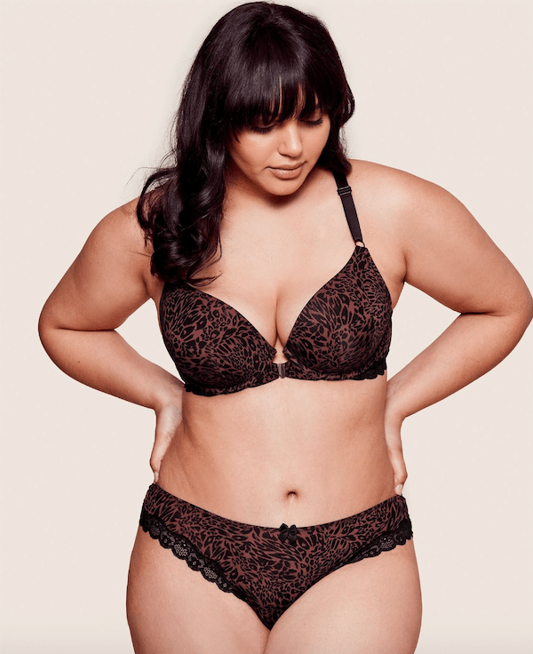 A plus-size model from Adore Me wearing an animal print lingerie set.