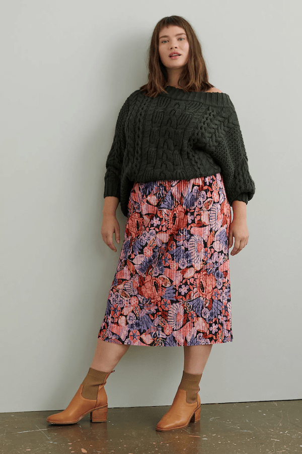 A plus-size model wearing a floral skirt.