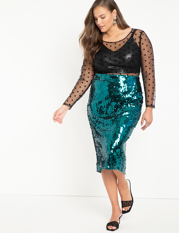 A plus-size model wearing a teal sequin skirt, which will be marked down at Eloquii's 2020 Black Friday sale.
