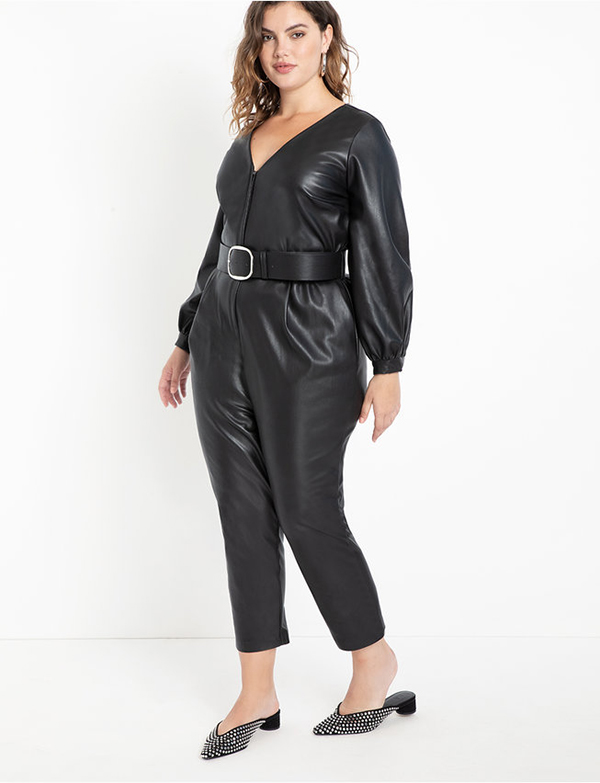 A plus-size model wearing a black leather jumpsuit, which will be marked down at Eloquii's 2020 Black Friday sale.