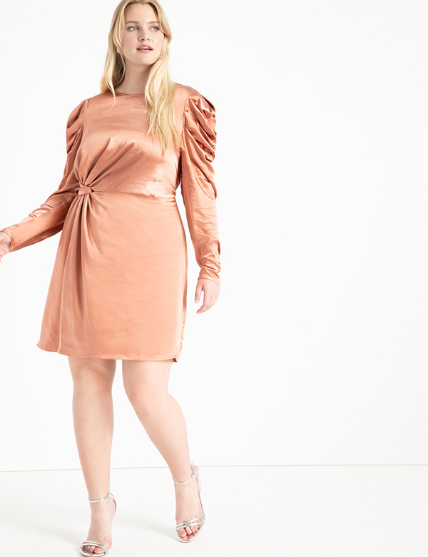 A plus-size model wearing a gold satin dress, which will be marked down at Eloquii's 2020 Black Friday sale.