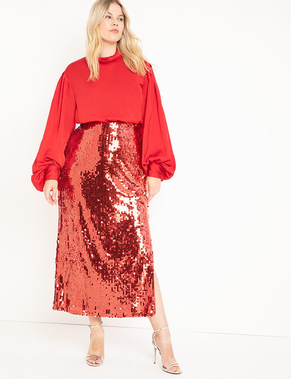 A plus-size model wearing a red sequin skirt, which will be marked down at Eloquii's 2020 Black Friday sale.