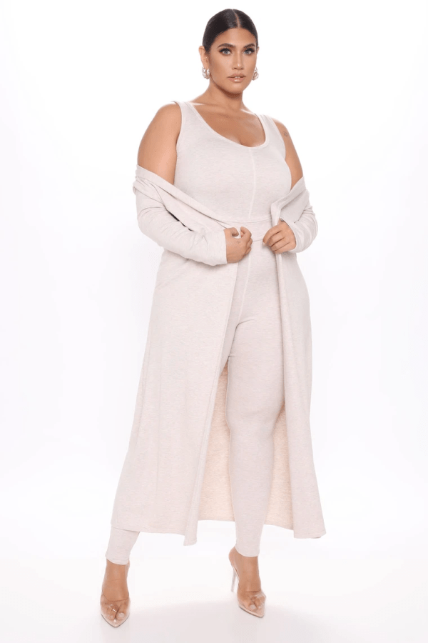 A plus-size model from Fashion Nova wearing cream lounge set.
