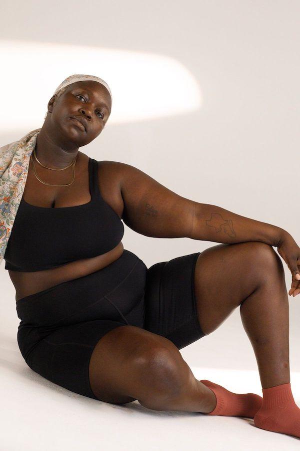 A plus-size model from Girlfriend wearing black bike shorts.