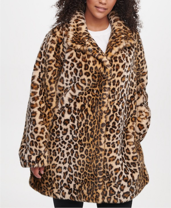 A plus-size model from Macy's wearing a faux fur leopard print coat.
