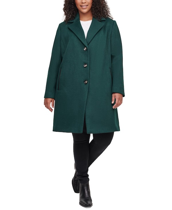 A plus-size model from Macy's wearing an emerald green peacoat.
