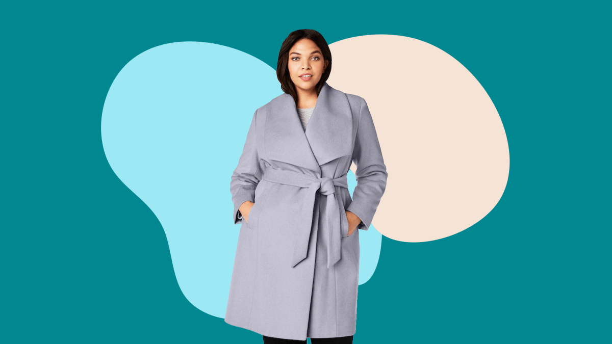 A plus-size model from Macy's wearing a light purple tie coat.