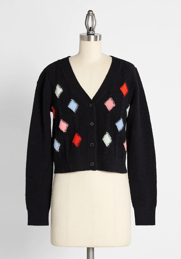 A navy patterned cardigan sweater from ModCloth.