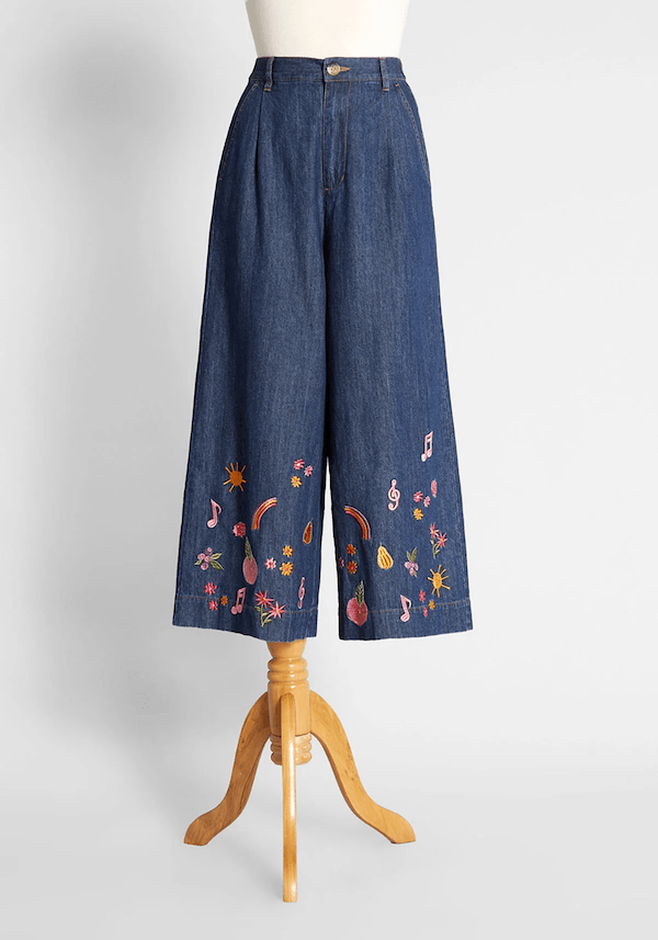 A pair of denim jeans with embroidery on the bottom from ModCloth.