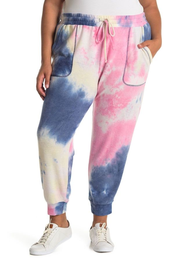 A plus-size model from Nordstrom Rack wearing tie-dye sweatpants.