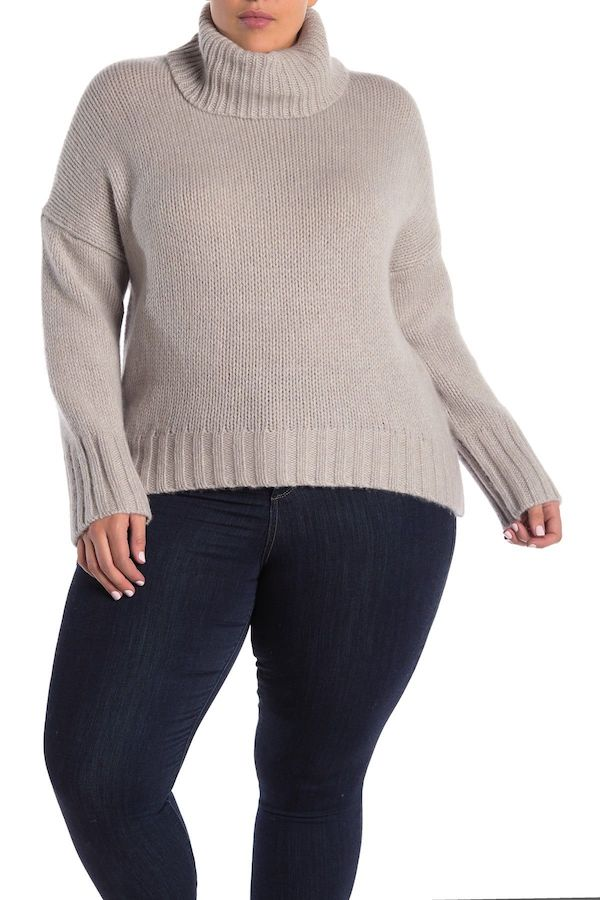 A plus-size model from Nordstrom Rack wearing a gray turtleneck sweater.