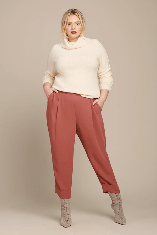 A plus-size model wearing pink trousers, which are currently marked down at 11 Honore's 2020 Black Friday sale.