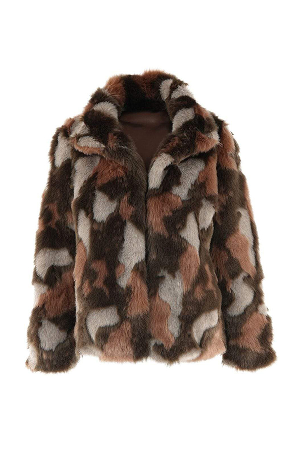 A plus-size faux fur coat, which is currently marked down at CoEdition's 2020 Black Friday sale.