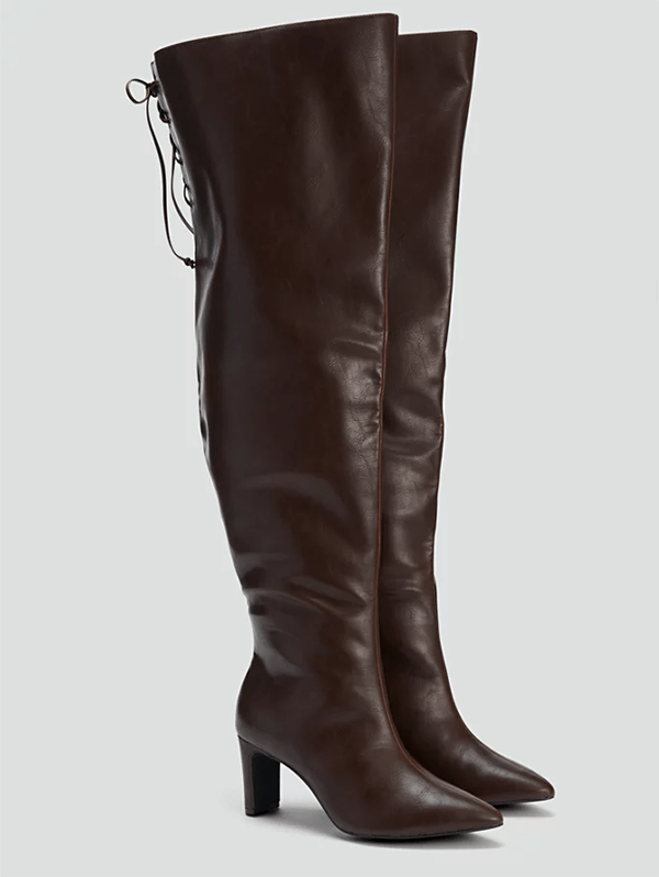 A pair of wide-calf over-the-knee brown boots, which will be marked down at Fashion to FIgure's 2020 Black Friday sale.