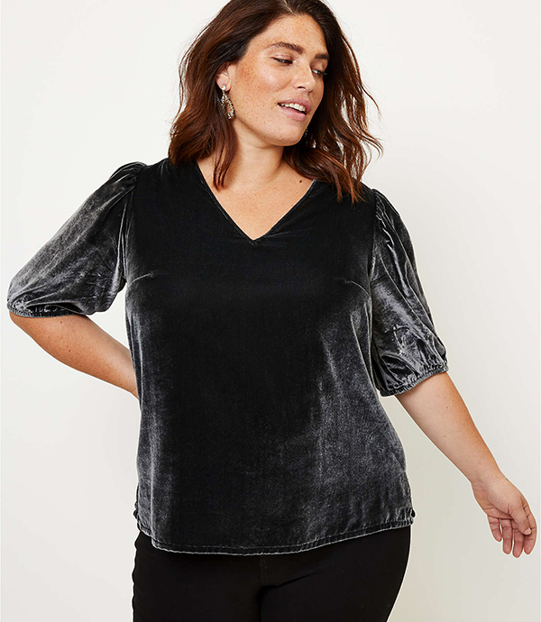 A plus-size model wearing a charcoal velvet top, which will be marked down at Loft's 2020 Black Friday sale.