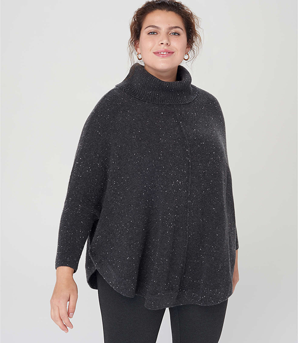 A plus-size model wearing a charcoal turtleneck sweater, which will be marked down at Loft's 2020 Black Friday sale.