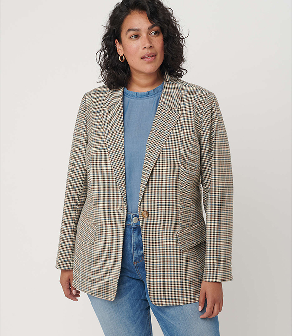 A plus-size model wearing a plaid blazer, which will be marked down at Loft's 2020 Black Friday sale.