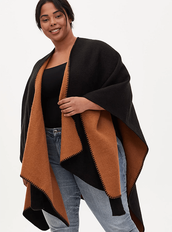 A plus-size model wearing a black shawl, which will be marked down at Torrid's 2020 Black Friday sale.