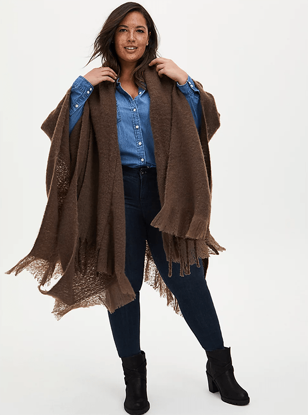 A plus-size model wearing a brown shawl, which will be marked down at Torrid's 2020 Black Friday sale.