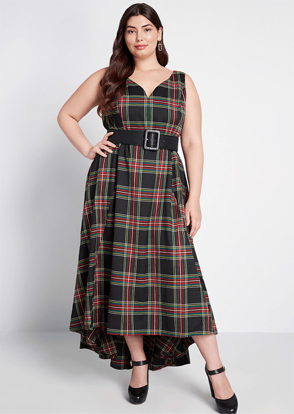 A plus-size model wearing a plaid holiday dress from ModCloth.