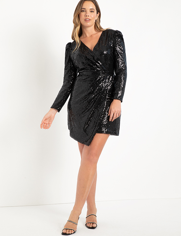 A plus-size model wearing a black sequin holiday dress from Eloquii.
