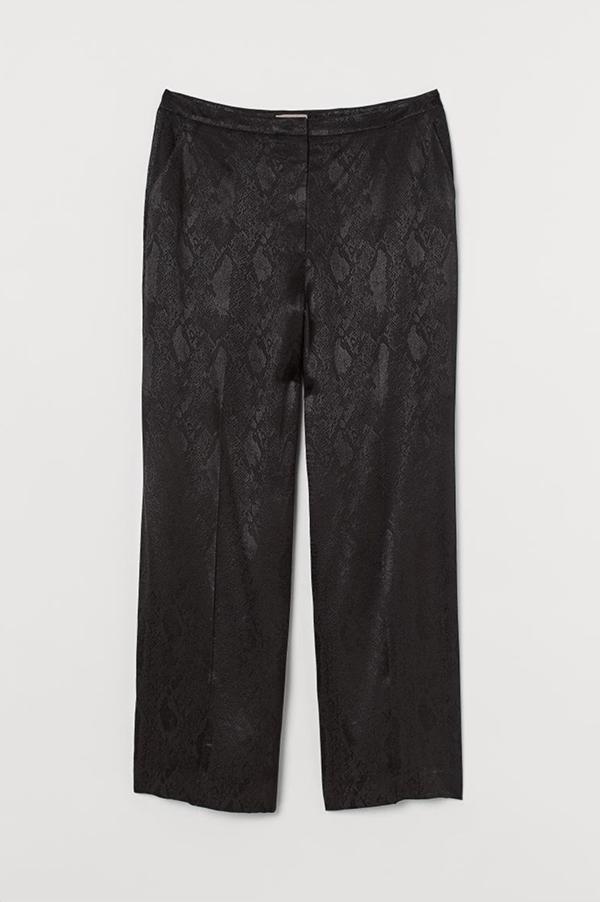 A pair of plus-size black snake print pants.