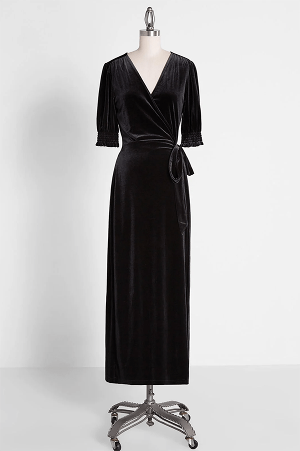 A plus-size black velvet wrap maxi dress.