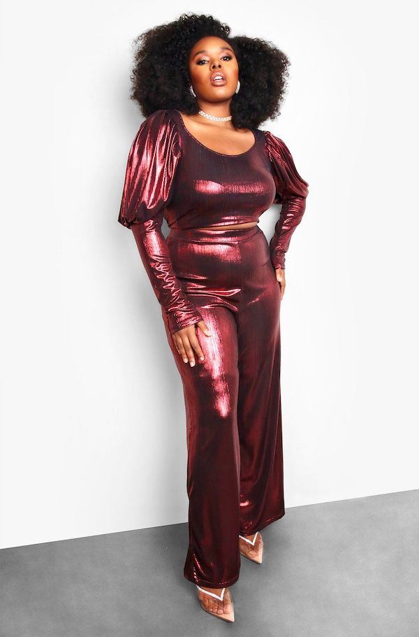 A model from Rebdolls wearing metallic red pants.