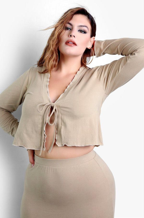 A model from Rebdolls wearing a tan tie-front cardigan.