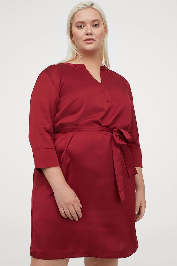 A plus-size model wearing a red dress from H&M.