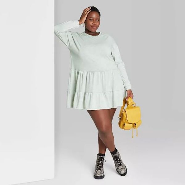 A plus-size model from Target wearing a mint green mini dress.