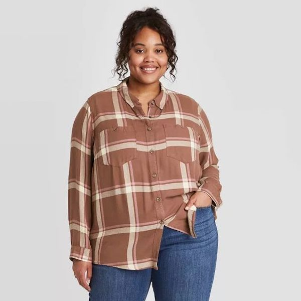 A plus-size model from Target wearing a brown plaid shirt.