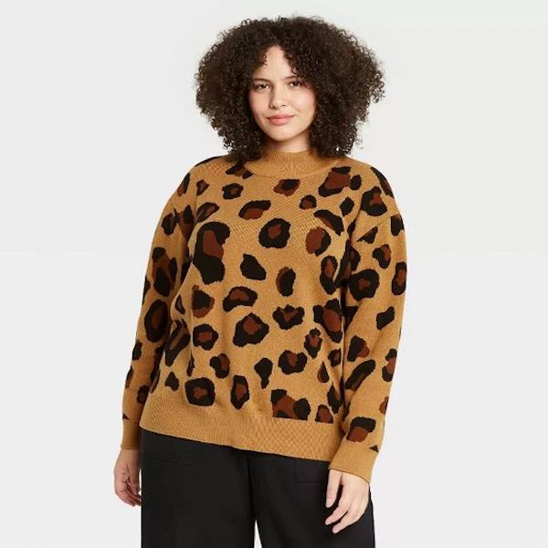 A plus-size model from Target wearing an animal print sweater.