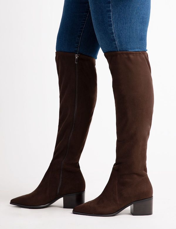 A pair of brown suede wide-calf thigh-high boots.