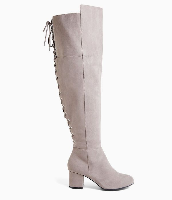 Off-white wide-calf thigh-high boots.