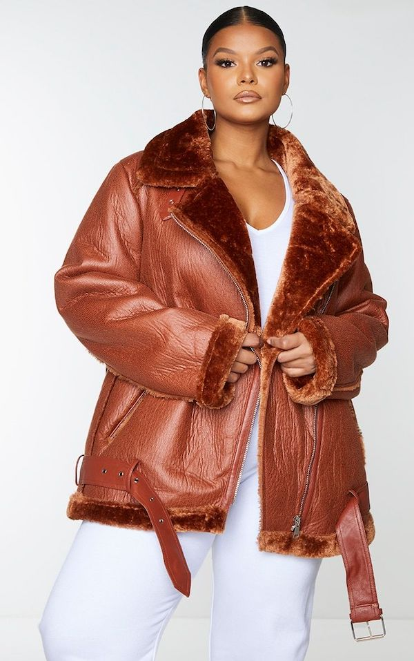 A model wearing a plus-size aviator jacket in brown.