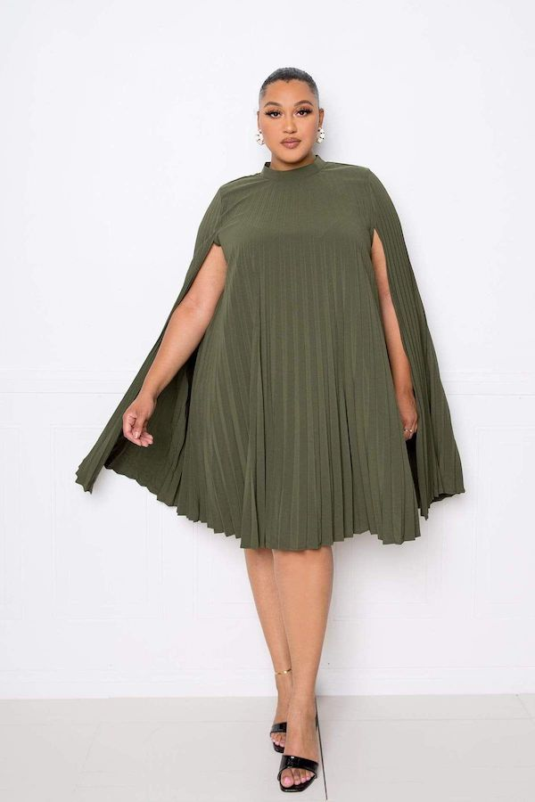 A model wearing a plus-size cape dress in olive green.