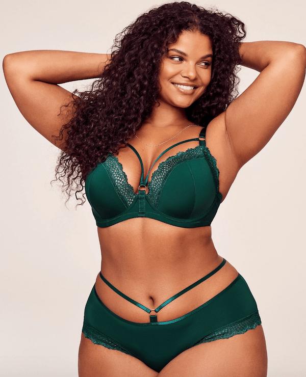 A model wearing plus-size green lingerie.