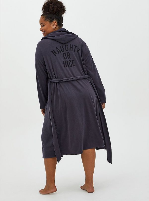 A model wearing plus-size Christmas robe.
