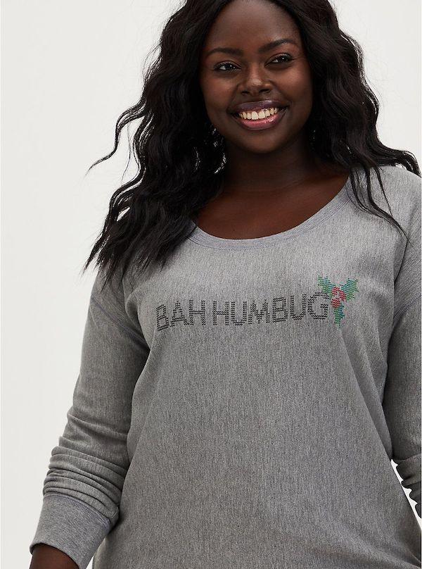 "A model wearing plus-size gray ""bah humbug"" sweatshirt."