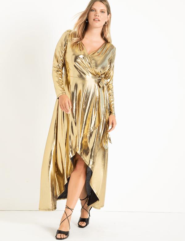 A model wearing a plus-size gold metallic maxi dress.