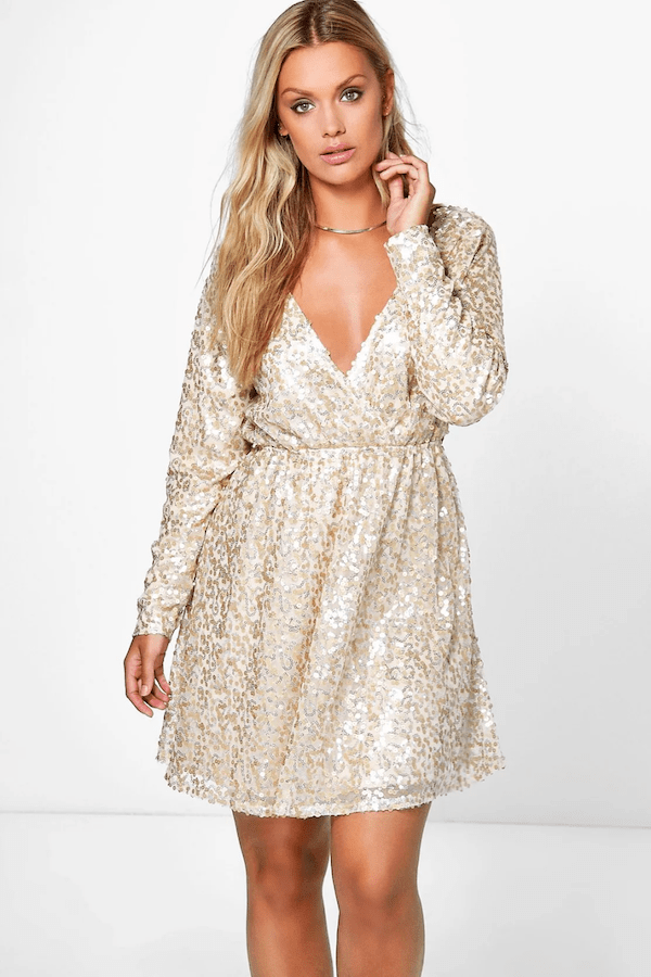 A model wearing a plus-size gold sequin mini dress.