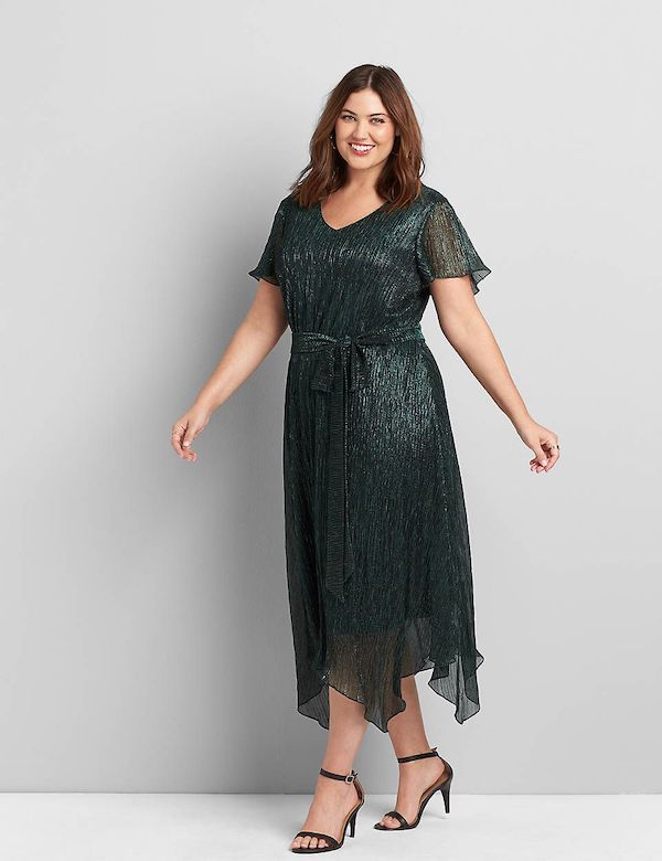 A model wearing a plus-size metallic green dress.