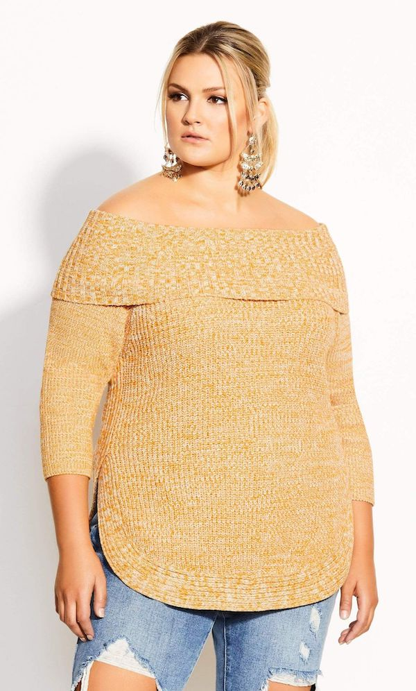 A model wearing a plus-size off-the-shoulder sweater in yellow.