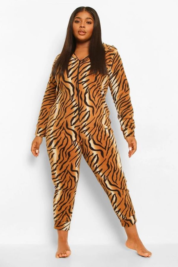 A model wearing a plus-size animal print onesie.